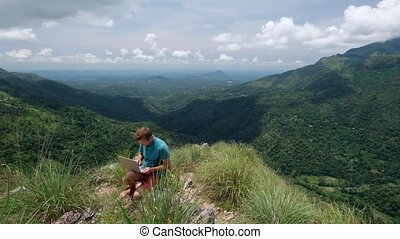 happy man with laptop on the hill - European man with laptop...
