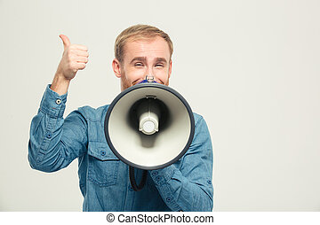 Happy man with megaphone showing thumb up - Portrait of a ...