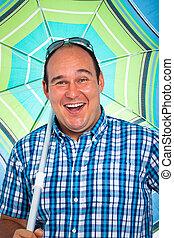 Happy man with parasol