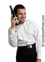 Happy man with wine bottle