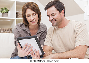 Happy Man & Woman Couple Using Tablet Computer at Home