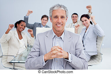 Happy manager and business team celebrating a sucess in the...