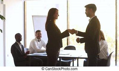 Happy manager handshake promote praise female employee for...