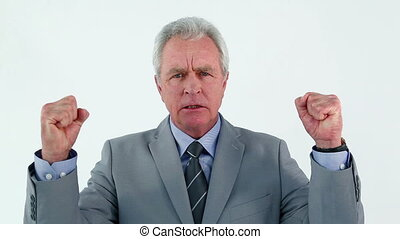 Happy manager raising his fists against a white background