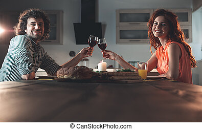 Happy married couple having romantic dinner at home