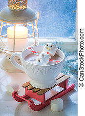 Happy marshmallows snowman for Christmas in hot chocolate