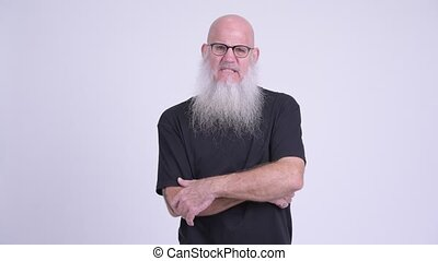 Happy mature bald bearded man getting good news - Studio...