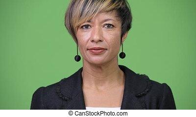 Happy mature beautiful multi-ethnic businesswoman - Studio...