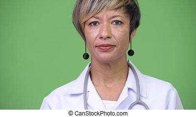 Happy mature beautiful multi-ethnic woman doctor - Studio...