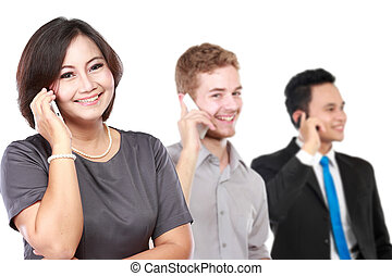 happy mature business women talking on the phone, with her staff