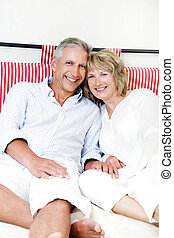 Happy mature couple at home