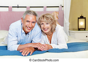 Happy mature couple at home - Lifestyle portrait of a happy...