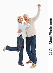 Happy mature couple cheering at camera on white background