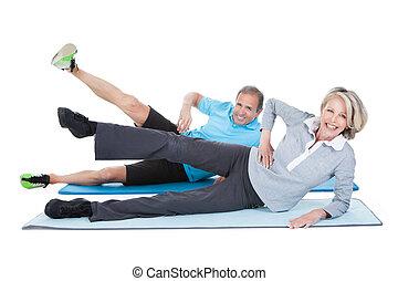 Mature Couple Exercising