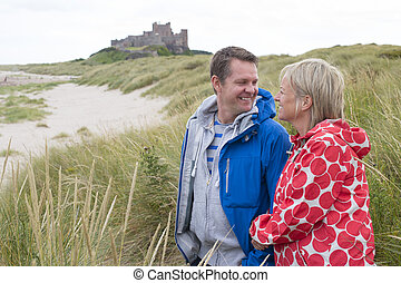 Happy Mature Couple - Happy Mature couple at the beach. They...