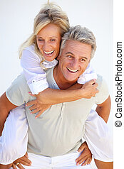 Happy mature couple having fun over white background.