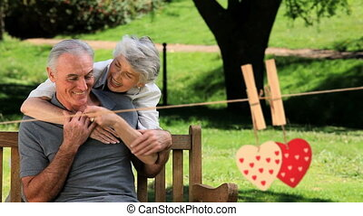 Happy mature couple hugging in a park