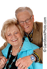 Happy mature couple hugging.