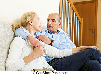 mature couple in home interior