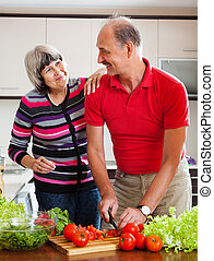happy mature couple  in home kitchen
