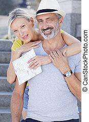 happy mature couple looking at camera