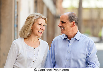 Happy mature couple looking at each other on a date