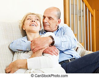 mature  couple  on sofa in home  interior