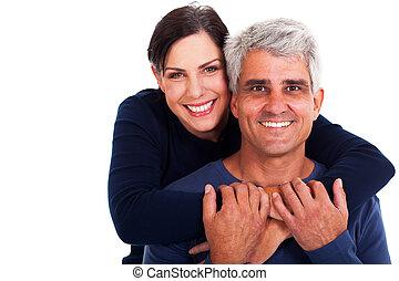 happy mature couple on white background