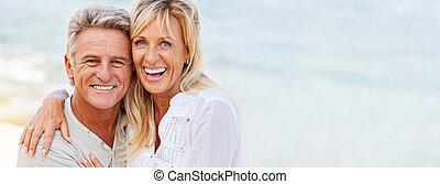 Portrait of a happy mature couple outdoors.