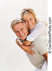 Portrait of a happy mature couple.