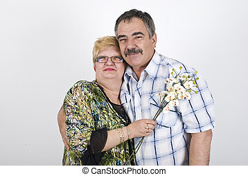 Happy mature couple with flowers