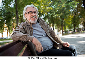 Happy mature man relaxing in the nature