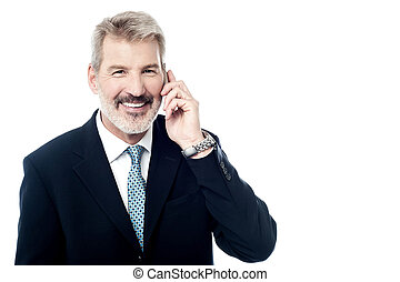 Happy mature man talking on cell phone