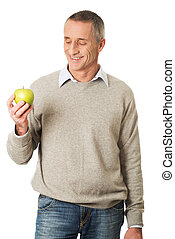 Happy mature man with an apple