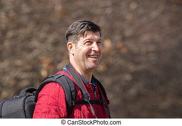Happy mature man with backpack