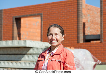 Happy mature woman against  building