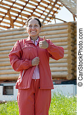 Happy  mature woman against building  home