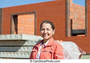 Happy mature woman against  building