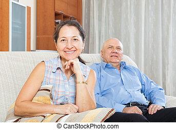 Happy mature woman against elderly man