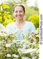 Happy mature woman at garden