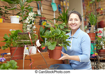 mature woman chooses auricula - Happy mature woman chooses...