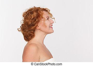 Happy mature woman - Closeup profile of happy mature woman...