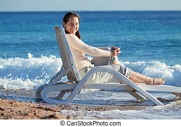mature woman enjoying  on sea beach