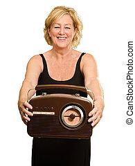 Happy Mature Woman Holding Radio Isolated On White...