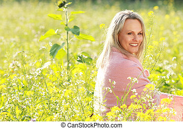 happy mature woman in a flowerfield - Attractive happy...