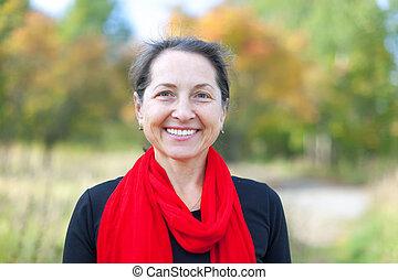 happy mature woman  in autumn park