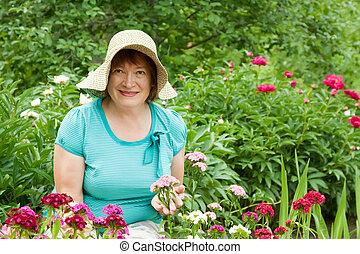 Happy mature woman in garden