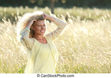 Happy mature Woman in nature