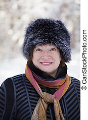 Happy mature woman in winter
