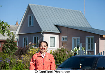Happy  mature woman near home